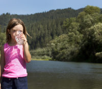 Girl sips water at Russian River