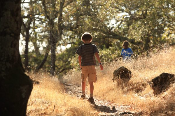A child walks along a trail at Montini Open Space Preserve.
