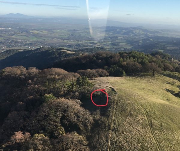 An aerial view of the rain gauge on the McCrea property atop Sonoma Mountain with a red circle around the gauge.